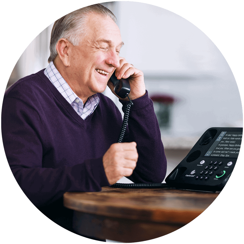 man with hearing loss using captioned telephone